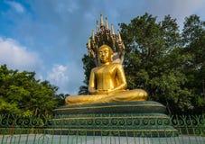Ο χρυσός Βούδας με ένα NA-GA Στοκ Εικόνες
