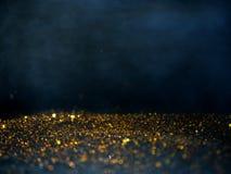 Ο χρυσός και το ασήμι ακτινοβολούν με το bokeh, μαύρο υπόβαθρο στοκ φωτογραφία