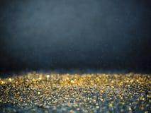 Ο χρυσός και το ασήμι ακτινοβολούν με το bokeh, μαύρο υπόβαθρο στοκ εικόνα