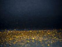 Ο χρυσός και το ασήμι ακτινοβολούν με το bokeh, μαύρο υπόβαθρο στοκ εικόνες