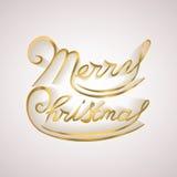 Ο χρυσός Χαρούμενα Χριστούγεννας ακτινοβολεί γράφοντας Στοκ φωτογραφία με δικαίωμα ελεύθερης χρήσης