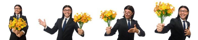 Ο όμορφος επιχειρηματίας με το λουλούδι που απομονώνεται στο λευκό στοκ φωτογραφία