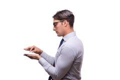 Ο όμορφος επιχειρηματίας που εργάζεται το κινητό τηλέφωνο που απομονώνεται με στο λευκό Στοκ Εικόνες