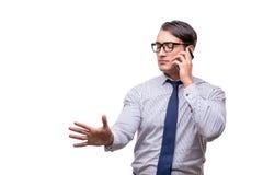 Ο όμορφος επιχειρηματίας που εργάζεται το κινητό τηλέφωνο που απομονώνεται με στο λευκό Στοκ Φωτογραφία