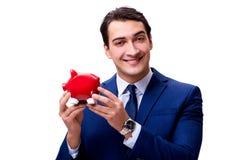Ο όμορφος επιχειρηματίας το piggybank που απομονώνεται με στο λευκό Στοκ εικόνες με δικαίωμα ελεύθερης χρήσης