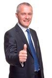 Ο ώριμος επιχειρηματίας φυλλομετρεί επάνω. στοκ εικόνα με δικαίωμα ελεύθερης χρήσης
