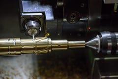Ο CNC τέμνων ορείχαλκος αυλακώσεων μηχανών στροφής ή τόρνου ahst Στοκ Φωτογραφία