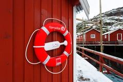 Ο lifebuoy στον τοίχο ενός σπιτιού Στοκ Εικόνα