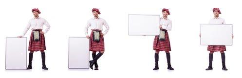 Ο scotsman με τον κενό πίνακα στο λευκό Στοκ φωτογραφία με δικαίωμα ελεύθερης χρήσης