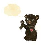 ο teddy Μαύρος κινούμενων σχεδίων αντέχει με το σχισμένο βραχίονα με τη σκεπτόμενη φυσαλίδα Στοκ Φωτογραφία