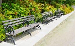 Πάγκοι σε ένα πάρκο Στοκ Εικόνες