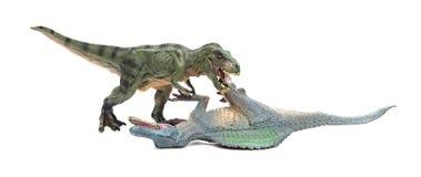 Πάλες τυραννοσαύρων με το spinosaurus στο άσπρο υπόβαθρο στοκ εικόνες με δικαίωμα ελεύθερης χρήσης