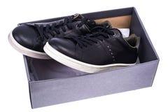 Πάνινα παπούτσια μαύρων ` s με τα άσπρα πέλματα Στοκ Εικόνα