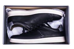 Πάνινα παπούτσια μαύρων ` s με τα άσπρα πέλματα Στοκ Φωτογραφία