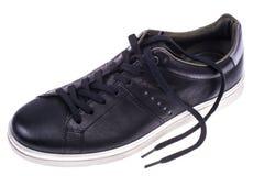 Πάνινα παπούτσια μαύρων ` s με τα άσπρα πέλματα Στοκ εικόνα με δικαίωμα ελεύθερης χρήσης