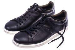 Πάνινα παπούτσια μαύρων ` s με τα άσπρα πέλματα Στοκ φωτογραφίες με δικαίωμα ελεύθερης χρήσης