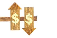 πάνω-κάτω το κείμενο δολαρίων στο ξύλινο βέλος στο άσπρο υπόβαθρο Στοκ Εικόνα