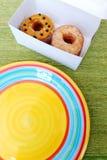 Πάρτε έξω doughnuts το πρόχειρο φαγητό Στοκ Φωτογραφίες
