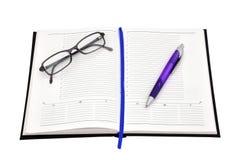 πέννα γυαλιών ημερολογίων Στοκ Φωτογραφία