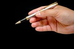 πέννα εκμετάλλευσης χεριών Στοκ εικόνες με δικαίωμα ελεύθερης χρήσης