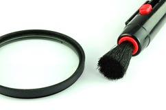Πέννα και βούρτσα φακών τσεπών για τον καθαρισμό της φωτογραφικής μηχανής Στοκ εικόνες με δικαίωμα ελεύθερης χρήσης