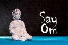 Πέστε το OM - διατυπώστε με το λίγο προσευμένος Βούδα Έννοια γιόγκας και περισυλλογής Στοκ Φωτογραφία