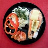 Πέστροφα που ψήνεται με το τυρί στοκ εικόνες