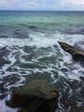 Πέτρες που πλένονται από το κύμα θάλασσας Στοκ Φωτογραφία