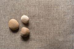 Πέτρες sackcloth στο υπόβαθρο Στοκ Εικόνα