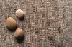 Πέτρες sackcloth στο υπόβαθρο Στοκ Φωτογραφία