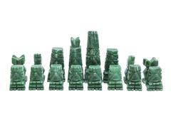 Πέτρινα παλαιά χειροποίητα κομμάτια σκακιού στο άσπρο υπόβαθρο Στοκ φωτογραφία με δικαίωμα ελεύθερης χρήσης