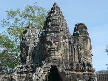 Πέτρινα πρόσωπα πέρα από την πύλη ανατολικών πόλεων, Καμπότζη Στοκ Εικόνα