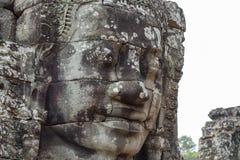 Πέτρινη ανακούφιση προσώπου του αρχαίου βουδιστικού ναού Bayon σε Angkor Wat σύνθετο, Καμπότζη Επίσκεψη στην Καμπότζη Στοκ εικόνες με δικαίωμα ελεύθερης χρήσης