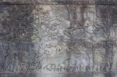 Πέτρινη χάραξη στο ναό Angkor Wat στην Καμπότζη Στοκ εικόνα με δικαίωμα ελεύθερης χρήσης