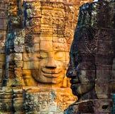 Πέτρινοι τοιχογραφίες και ναός Angkor Thom Bayon αγαλμάτων Angkor Wat Στοκ Φωτογραφίες