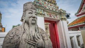 Πέτρινος Ταϊλανδός - κινεζικό γλυπτό ύφους και ταϊλανδική αρχιτεκτονική τέχνης στο ναό Wat Phra Chetupon Vimolmangklararm (Wat Ph Στοκ εικόνες με δικαίωμα ελεύθερης χρήσης
