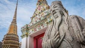 Πέτρινος Ταϊλανδός - κινεζικό γλυπτό ύφους και ταϊλανδική αρχιτεκτονική τέχνης στο ναό Wat Phra Chetupon Vimolmangklararm (Wat Ph Στοκ Εικόνα