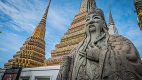 Πέτρινος Ταϊλανδός - κινεζικό γλυπτό ύφους και ταϊλανδική αρχιτεκτονική τέχνης στο ναό Wat Phra Chetupon Vimolmangklararm (Wat Ph Στοκ Φωτογραφίες