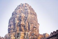 Πέτρινο άγαλμα προσώπου στον αρχαίο ναό Angkor Thom, Καμπότζη Bayon Στοκ εικόνα με δικαίωμα ελεύθερης χρήσης