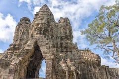 Πέτρινο πρόσωπο στην πύλη του ναού Angkor Thom, Angkor Wat, Καμπότζη Στοκ φωτογραφία με δικαίωμα ελεύθερης χρήσης