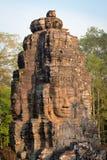 Πέτρινο πρόσωπο στον αρχαίο ναό Bayon, Angkor στην Καμπότζη Στοκ Εικόνες