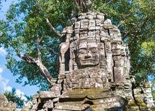 Πέτρινο πρόσωπο στο khmer πύργο στο ναό Angkor Wat στην Καμπότζη Στοκ Εικόνα