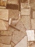 Πέτρινο υπόβαθρο σύστασης πορειών οδικών κεραμιδιών επίστρωσης πατωμάτων καφετί παλαιό Στοκ φωτογραφία με δικαίωμα ελεύθερης χρήσης