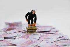 Πίθηκος και χρήματα Στοκ φωτογραφία με δικαίωμα ελεύθερης χρήσης