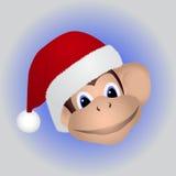Πίθηκος σε μια ΚΑΠ Santa Στοκ Εικόνες