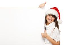 Πίνακας διαφημίσεων εκμετάλλευσης κοριτσιών Santa που παρουσιάζει αντίχειρα στοκ φωτογραφία