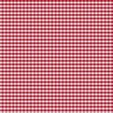 Πίνακας που καλύπτεται από το κόκκινο ελεγμένο τραπεζομάντιλο ή Στοκ φωτογραφία με δικαίωμα ελεύθερης χρήσης