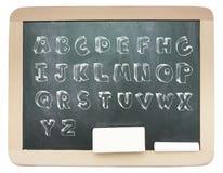 Πίνακας το περιγραμματικό κύριο αλφάβητο που γράφεται με σε το Στοκ φωτογραφίες με δικαίωμα ελεύθερης χρήσης