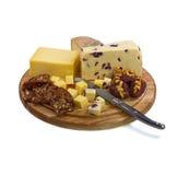 Πίνακας τυριών με τρία τυριά και μαχαίρι ο τυριών Στοκ Φωτογραφίες