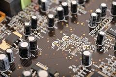 Πίνακας υπολογιστών με τους πυκνωτές Στοκ Εικόνα